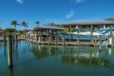 Marina with boats and boat houses in Southwest Florida built by Florida Marine Construction